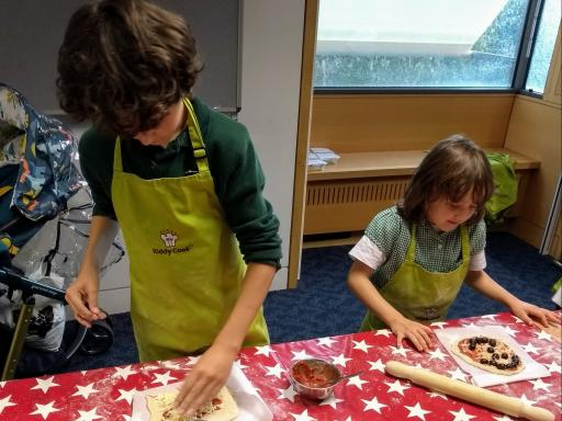 Two children cooking at Norfolk libraries